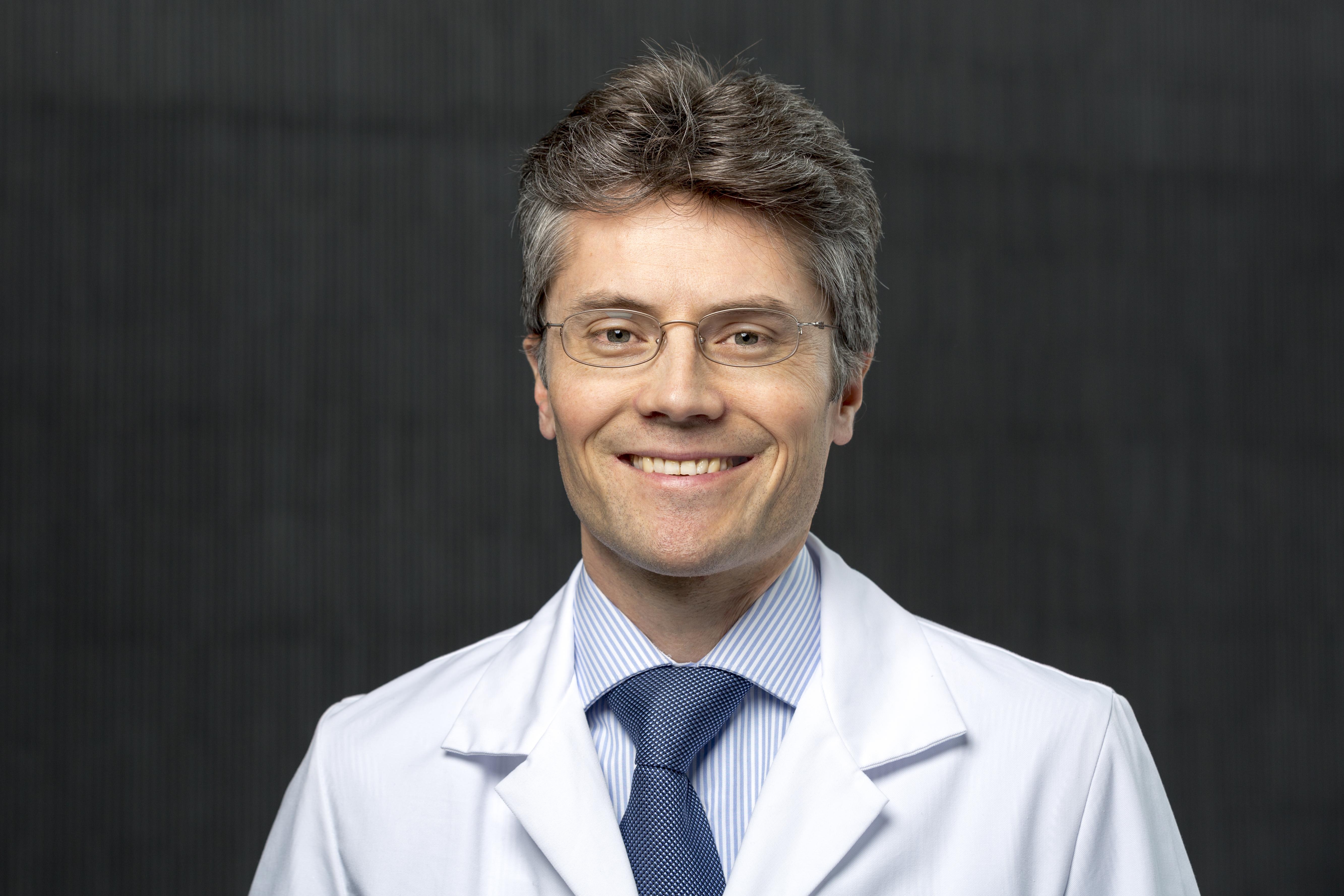 Dr. Adrian Häne, MD